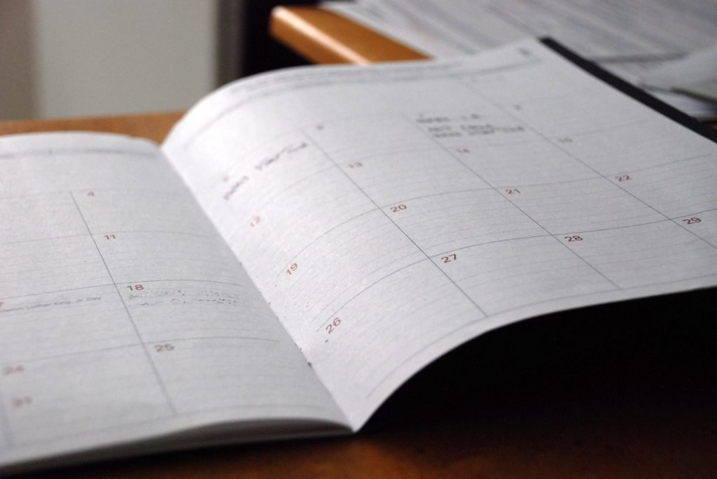Use your current knowledge and visualization to plan your week and next day accordingly (Paper calendar closeup)
